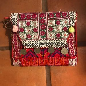 Handbags - Clutch in Color textiles embellished.